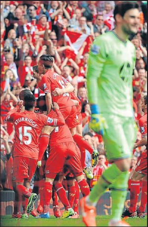 ?? Picture: PA. ?? Liverpool players celebrate after Younes Kaboul's own goal.