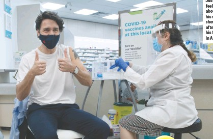 ??  ?? Prime Minister Justin Trudeau feeling good about getting his vaccines; shown here after receiving his first dose in April.