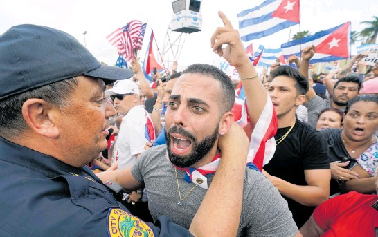 ?? Photo / AP ?? People in Miami's Little Havana neighbourhood rally in support of anti-government demonstrations in Cuba.