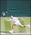 ??  ?? Serbia's Novak Djokovic plays a return to Italy's Matteo Berrettini during the men's singles final on day thirteen of the Wimbledon Tennis Championships in London, Sunday, July 11, 2021. (AP)