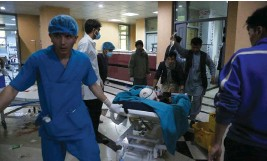 ?? Picture: AFP ?? VICTIM. An injured man is taken to a hospital following a blast outside a school in west Kabul on Saturday.
