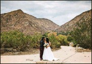 """?? PRITCHARD PHOTOGRAPHY VIA AP KRISTEN ?? In this Sunday, Dec. 27, 2020 photo provided by Kristen Pritchard Photography, Kayleigh and Cody Cousins pose for wedding photos at Mission Trails Regional Park in San Diego, Calif. They initially planned an April 2020 wedding, postponed it after the pandemic took hold, rescheduled it for December, then had to shift gears again when a new lockdown was imposed. """"That was devastating,"""" said Kayleigh. """"We said, 'Let's just do it on Zoom.'"""""""