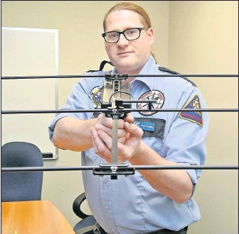 ?? Darrell Cole/Amherst News ?? Christopher Gooding of Springhill Ground Search and Rescue shows the Project Lifesaver equipment that was used in a successful search for a missing teen last Sunday in Ward's Brook.