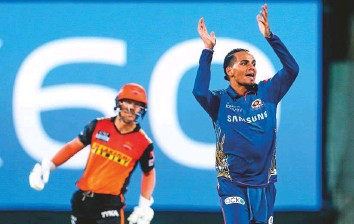 ?? ANI ?? Rahul Chahar of Mumbai Indians celebrates the wicket of Manish Pandey of Sunrisers Hyderabad during their Indian Premier League match in Chennai yesterday.