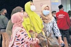?? SYUFLANA/AP TATAN ?? Relatives of missing passengers arrive at a crisis center set up Saturday at Soekarno-Hatta International Airport in Tangerang, Indonesia.