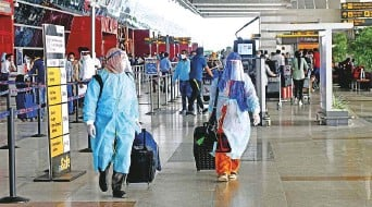 ?? ANI ?? ■ Passengers at New Delhi airport. Diagnostic centres conducting Covid-19 tests are nearing breaking point in Indian cities like New Delhi and Mumbai. Picture for illustrative purposes.