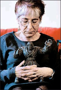 """??  ?? Lehrer holds a golem figure in her Edgewater home. Her memoir, """"Golem Girl,"""" was released last year to excellent reviews."""