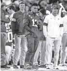 ?? BUTCH DILL/USA TODAY ?? Alabama's Tua Tagovailoa (13) watched from the sideline Saturday after ankle surgery last week.