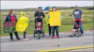 """?? ANGELA FOWLER PHOTO ?? One of the signs held by a protestor at the Quebec-labrador border on Friday morning reads: """"Does someone have to die? Fix our highway."""""""