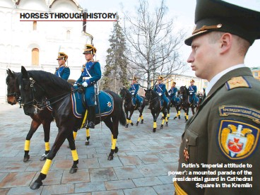 ??  ?? Putin's 'imperial attitude to power': a mounted parade of the presidential guard in Cathedral square in the Kremlin