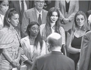 ?? ANNA MONEYMAKER/ GETTY IMAGES ?? From left, Aly Raisman, Simone Biles, McKayla Maroney and Maggie Nichols appear before members of the Senate Judiciary Committee to discuss the FBI's handling of the Larry Nassar investigation.