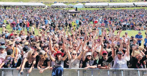 ?? PHOTOS: MATTHEW MCKEW ?? Final act excitement . . . Fans begin to gather at the front of the stage for the final act of the day, Gin Wigmore, at the Gibbston Valley Winery Summer Concert on Saturday.