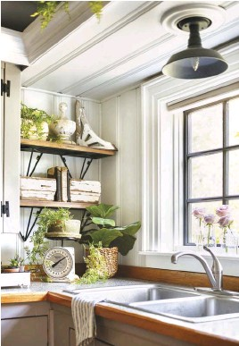 """??  ?? ORGANIC WOOD TONES give the kitchen the rustic vibe that Andrea loves. Both the walls and floors were pine but needed sanding and urethane to bring out their natural honey pine color. """"We spent many hours working on them to reveal a whole new look,"""" Andrea says."""