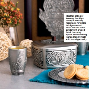 ??  ?? Ideal for gifting or keeping, the Atiya caddy is a worthy receptacle for edible indulgences and more. In satin finish pewter with a wood finial, the caddy sports a mesmerising leaf and tendril motif with formal geometry.