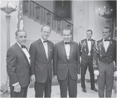 ?? PHOTO BY THE RICHARD NIXON LIBRARY & MUSEUM ?? In this Nov. 4, 1969, image provided by The Richard Nixon Library & Museum, President Richard Nixon, center, stands with Prince Philip, second from left, prior to a black tie state dinner.