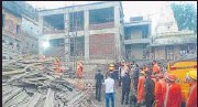 ?? HT ?? Rescue work underway at the site of building collapse.
