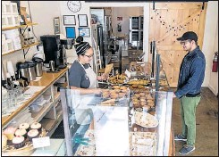 ??  ?? RIGHT: Trish Honaker opened Wonder City Bakery about a month ago in Hopewell's downtown. Customer Crisman White also runs a nearby business — an escape room called Room ESC.