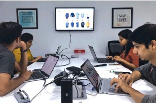 ??  ?? The GoFynd.io team at work in the company's Mumbai office