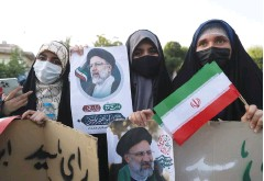 ?? (Majid Asgaripour/WANA/Reuters) ?? SUPPORTERS OF Iranian presidential candidate Ebrahim Raisi hold posters of him during an election rally in Tehran last week.