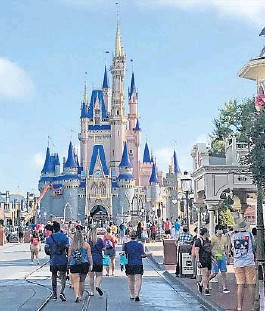 ?? GABRIELLE RUSSON/ORLANDO SENTINEL ?? Disney annual passholders get a peek at the coronavirus-inspired changes inside the Magic Kingdom on Thursday. Epcot and Disney's Hollywood Studios theme parks are set to reopen Wednesday.