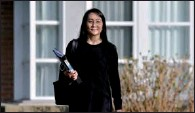 ?? JENNIFER GAUTHIER / REUTERS ?? Huawei Technologies Chief Financial Officer Meng Wanzhou leaves her home to attend a court hearing in Vancouver on March 22.