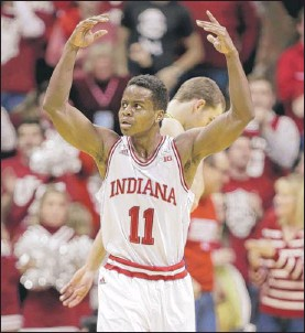 ?? | AP PHOTO ?? Indiana guard Yogi Ferrell celebrates as Michigan calls a timeout in the second half Sunday in Bloomington. Indiana defeated Michigan 63-52.
