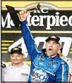 ??  ?? Kevin Harvick celebrates with the trophy after winning the NASCAR Cup Series auto race at Kansas Speedway on May 12, in Kansas City, Kansas. (AP)