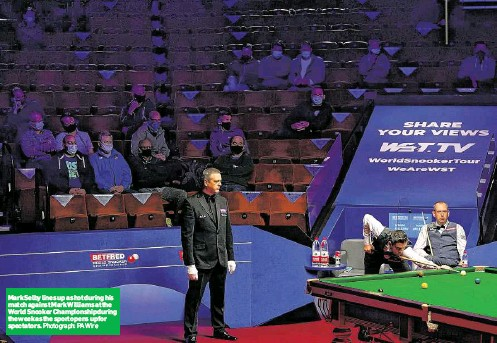 ?? Photograph: PA Wire ?? Mark Selby lines up a shot during his match against Mark Williams at the World Snooker Championship during the week as the sport opens up for spectators.