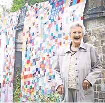 ??  ?? Proud as punch One of the oldest contributors to take part, Jessie Boardman, stands by the finished artwork
