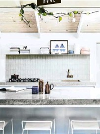 ??  ?? Baby blue cabinets topped with concrete tops made by Damian make the heart of the home a show-stopping one.