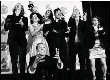 ?? Herald Archive, McClatchy Newspapers ?? The Album of the Year award, which went this year to Montreal's Arcade Fire, above, remained unscathed in the Grammy revamp.