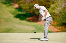 ?? Jared C. Tilton / Getty Images ?? Russell Henley putts on the 18th green during the second round of the Wyndham Championship. He is 14 under after two rounds.