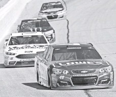 ?? JOHN DAVID MERCER, USA TODAY SPORTS ?? Jimmie Johnson won Sunday's well-received race, 2016's first with a lower downforce aero package on a 1.5-mile track.