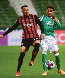 ?? PIC AFP ?? Bremen's Theodor Gebre Selassie (right) and Frankfurt's Filip Kostic vie for the ball in their Bundesliga match on Friday.