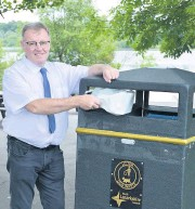 ??  ?? Cleaning up Environment convener Michael Mcpake with one of the new large-scale litter bins being put in place across the authority