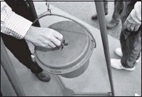 ?? THE ASSOCIATED PRESS ?? In 2018, a person donated to a Salvation Army Red Kettle in Georgia. With the COVID-19 pandemic and the loss of in-person fundraising opportunities, charitable giving is more important than ever.