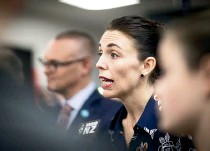 ?? ROSA WOODS/ STUFF ?? Prime Minister Jacinda Ardern and Health Minister David Clark, at rear, unveiled the Government's cancer care plan yesterday at Wellington Regional Hospital.