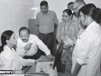 ?? — PTI ?? Union health minister Harsh Vardhan interacts with health officials during a visit to the CGHS dispensary at North Avenue in New Delhi on Monday.