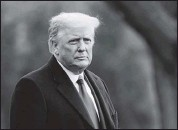 ?? THE ASSOCIATED PRESS ?? President Donald Trumpwalked on the South Lawn of the White House in Washington before boarding Marine One on Dec. 12.