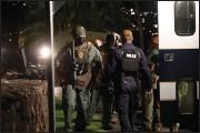 ?? (AP/Honolulu Star-Advertiser/Cindy Ellen Russell) ?? Authorities work late Saturday outside The Kahala Hotel & Resort in Honolulu.