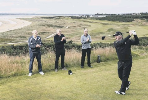 ??  ?? 0 Members watch as Paul Lawrie tees off at the redesigned 7th hole on the Championship course at Royal Dornoch.