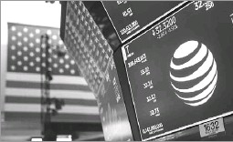 ?? Drew Angerer/getty Images ?? AT&T plans to close the deal with Time Warner before Wednesday, AT&T general counsel David Mcatee said. The telecom has been in a holding pattern for months.