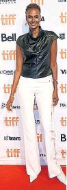 """??  ?? Yasmin Warsame showed how to make pants red carpet-worthy at the """"Oscar Peterson: Black and White"""" photo call."""