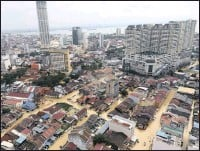 ?? PICTURE: AP ?? An aerial view shows a flooded George Town city in Penang, Malaysia, yesterday. A northern Malaysian state has been paralysed by a severe storm that led to two deaths and some 2000 people evacuated in the worst flooding in years, officials say.