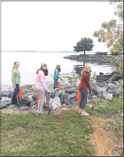 ?? PHOTO COURTESY OF KIMBERLY ANDREEN ?? Volunteers Edie Benner, Katherine Weber, Faith Andreen and Ellianna Andreen participate in last year's River Sweep Reimgained by removing trash from the Promenade in Havre de Grace.