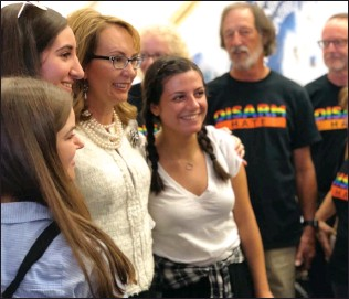 ?? Courtesy photo ?? Gabrielle Giffords, third from the left, takes a picture while speaking to Katie Hill's supporters at her Stevenson Ranch headquarters. Giffords is a former congresswoman from Arizona.