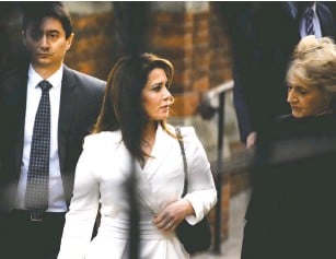 ?? CHRIS J. RATCLIFFE/GETTY IMAGES ?? A year after Princess Latifa's attempted escape, Princess Haya, one of the sheikh's six wives, made her own. Here she arrives last year at a court in London, where she fled with her children.