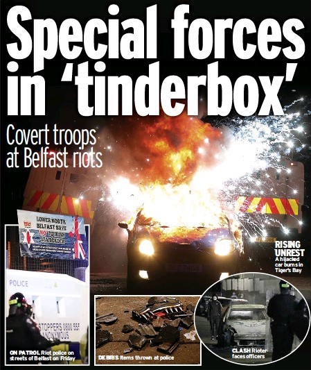 ??  ?? DEBRIS Items thrown at police CLASH Rioter faces officers RISING UNREST A hijacked car burns in Tiger's Bay
