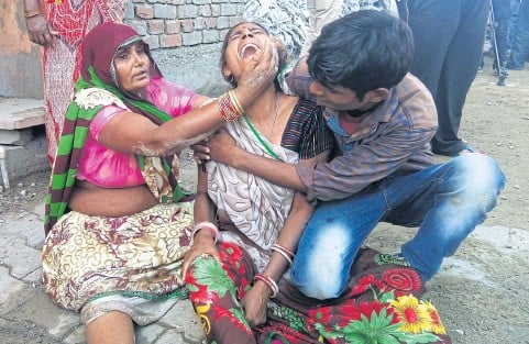 ?? AFP ?? A woman cries after a wall collapsed during a wedding, killing at least 24 people, in Bharatpur in India's Rajasthan state yesterday.