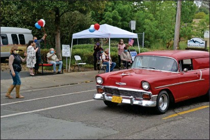 ?? PHOTO BY PETER ARMSTRONG ?? Al Bascou, seated at left, is treated to a classic car parade to celebrate his 94th birthday Monday in Ukiah.